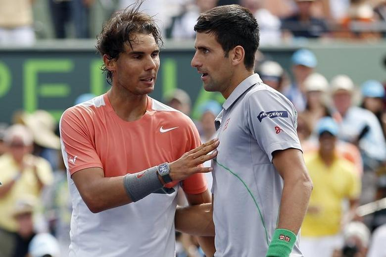 Mar 30, 2014; Miami, FL, USA; Novak Djokovic (right) shakes hands with Rafael Nadal (left) after winning the men's singles final of the Sony Open at Crandon Tennis Center. Djokovic won 6-3, 6-3. Mandatory Credit: Geoff Burke-USA TODAY Sports - RTR3J8A1