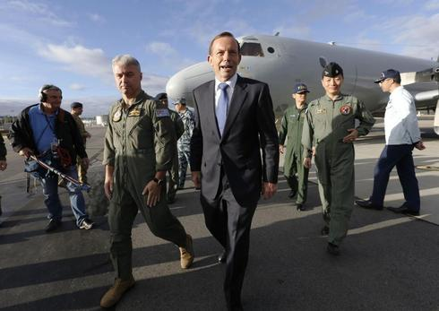 Australian PM says not putting time limit on hunt for missing Malaysian plane