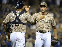 Mar 30, 2014; San Diego, CA, USA; San Diego Padres relief pitcher Huston Street (16) celebrates with catcher Yasmani Grandal (8) after winning the opening day baseball game against the Los Angeles Dodgers at Petco Park. Christopher Hanewinckel-USA TODAY Sports