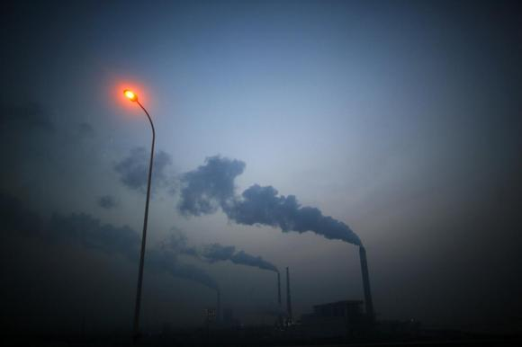 Smoke rises from chimneys of a thermal power plant near Shanghai March 26, 2014. REUTERS/Carlos Barria
