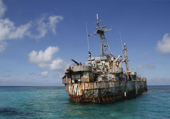 The BRP Sierra Madre, a marooned transport ship which Philippine Marines live on as a military outpost, is pictured in the disputed Second Thomas Shoal, part of the Spratly Islands in the South China Sea March 30, 2014. REUTERS/Erik De Castro