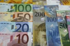 File photo illustration of various Euro banknotes lying next to various Swiss Franc notes at a bank in Warsaw, July 18, 2011. REUTERS/Kacper Pempel/Files