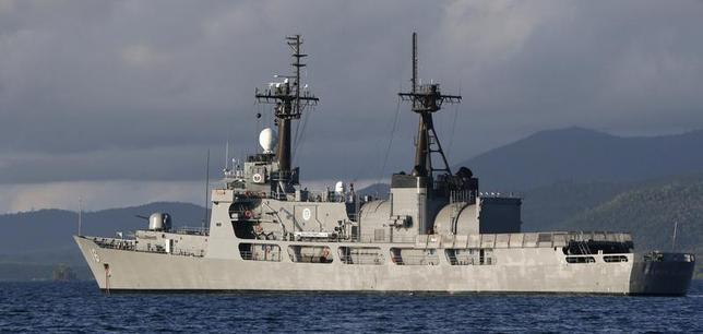 A Philippine warship BRP Ramon Alcaraz (PF 16) is pictured anchored in Ulugan Bay near a naval forces camp in Palawan province, southwest Philippines March 31, 2014. The Philippine government vessel made a dash for shallow waters around the disputed reef in the South China Sea on Saturday, evading two Chinese coastguard ships trying to block its path to deliver food, water and fresh troops to a military outpost on the shoal. REUTERS/Erik De Castro