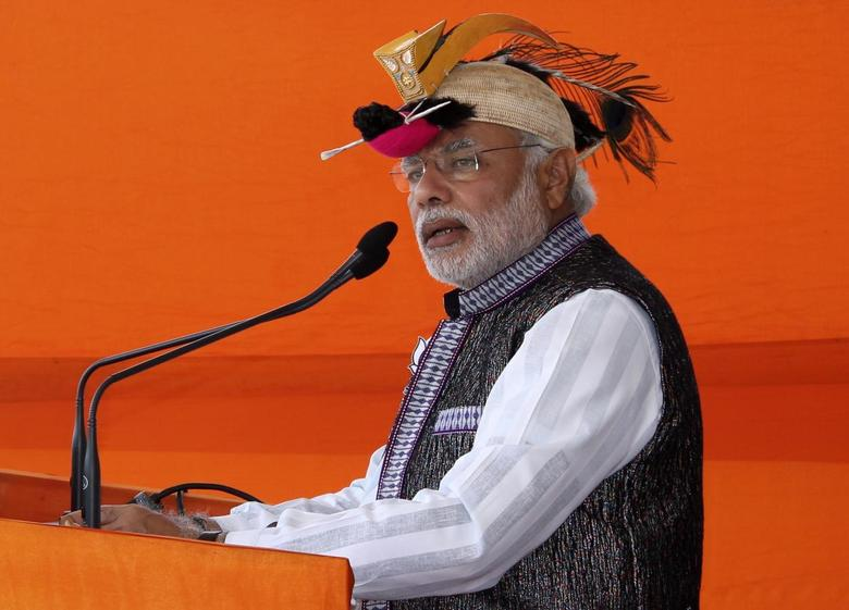 Hindu nationalist Narendra Modi, prime ministerial candidate for main opposition Bharatiya Janata Party (BJP) and Gujarat's chief minister, addresses his supporters during a rally ahead of the general election in Itanagar in the northeastern Indian state of Arunachal Pradesh March 31, 2014. REUTERS/Stringer