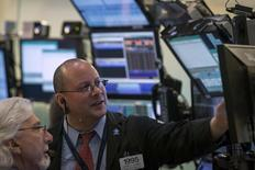 Traders work on the floor of the New York Stock Exchange March 28, 2014. REUTERS/Brendan McDermid