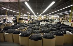 Outerwear ready for shipping is seen packed in boxes on the manufacturing floor of Canada Goose's facility in Toronto January 17, 2012. REUTERS/Fred Thornhill