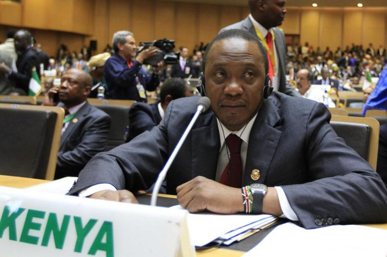 Kenya's President Uhuru Kenyatta attends the opening ceremony of the 22nd Ordinary Session of the African Union summit in Ethiopia's capital Addis Ababa, January 30, 2014. REUTERS/Tiksa Negeri