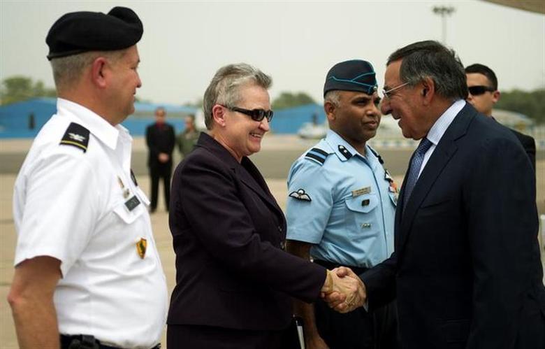 U.S. Defense Secretary Leon Panetta (R) shakes hands with U.S. ambassador to India Nancy Powell upon his arrival in New Delhi June 5, 2012. REUTERS/Jim Watson/Pool/Files