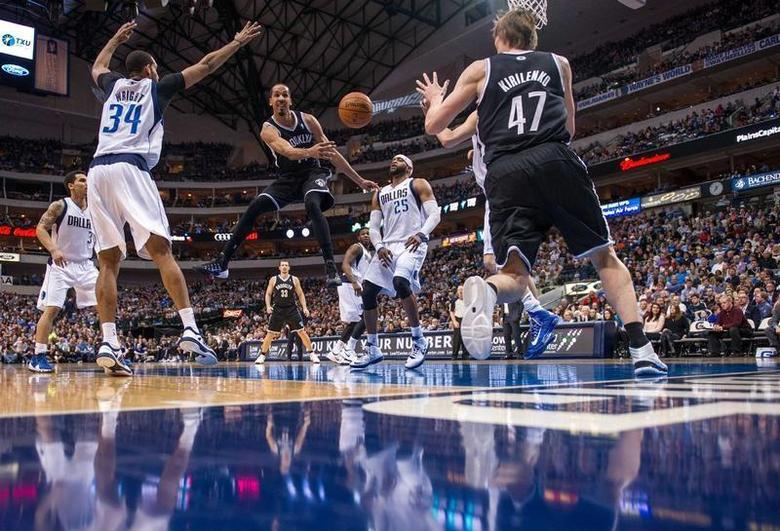 Mar 23, 2014; Dallas, TX, USA; Brooklyn Nets guard Shaun Livingston (14) passes to forward Andrei Kirilenko (47) during the first half against the Dallas Mavericks at the American Airlines Center. Jerome Miron-USA TODAY Sports - RTR3IA3C