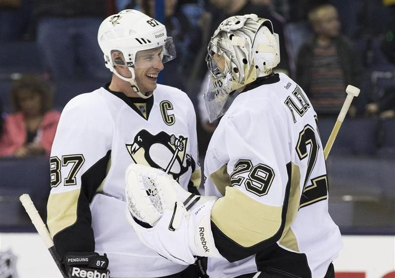 Mar 28, 2014; Columbus, OH, USA; Pittsburgh Penguins center Sidney Crosby (87) celebrates with goalie Marc-Andre Fleury (29) after defeating the Columbus Blue Jackets 2-1 at Nationwide Arena. Greg Bartram-USA TODAY Sports