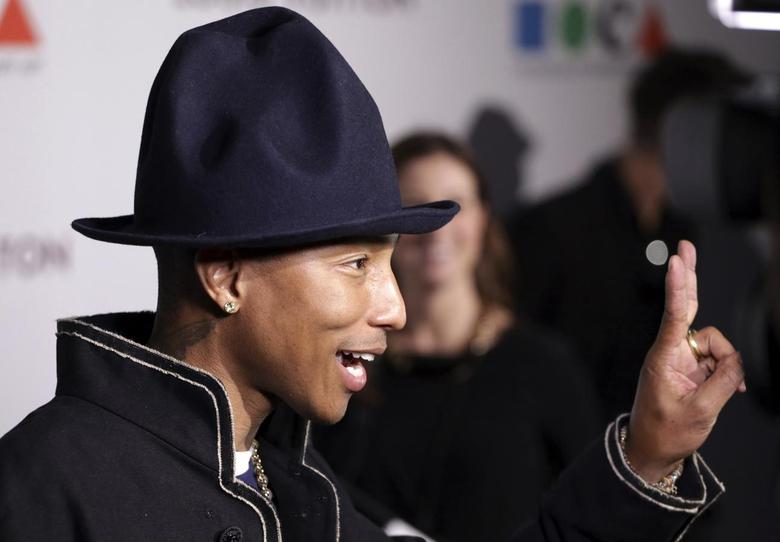 Singer Pharrell Williams gestures as he attends the Museum of Contemporary Art (MOCA)'s 35th Anniversary Gala presented by Louis Vuitton at The Geffen Contemporary at MOCA in Los Angeles, California March 29, 2014. REUTERS/Jonathan Alcorn