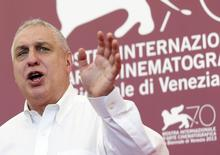 "Director Errol Morris gestures as he poses during a photocall for the movie ""The Unknown Known"" during the 70th Venice Film Festival in Venice September 4, 2013. REUTERS/Alessandro Bianchi"