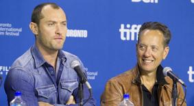 "Actors Jude Law and actor Richard E. Grant attend a news conference for the film ""Dom Hemingway"" at the 38th Toronto International Film Festival September 9, 2013. REUTERS/Fred Thornhill"