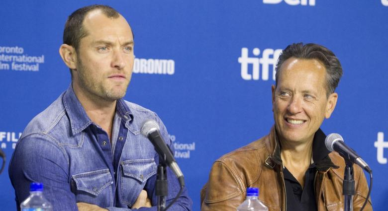 Actors Jude Law and actor Richard E. Grant attend a news conference for the film ''Dom Hemingway'' at the 38th Toronto International Film Festival September 9, 2013. REUTERS/Fred Thornhill