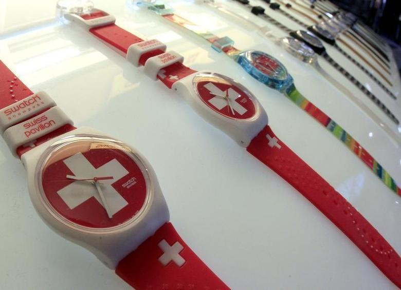 Swatch watches are displayed in front of a shop at the central station in Zurich February 4, 2013. REUTERS/Arnd Wiegmann