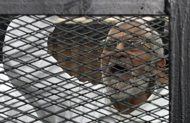 Muslim Brotherhood leader Mohammed Badie shouts slogans from the defendant's cage during his trial with other leaders of the Brotherhood in a courtroom in Cairo December 11, 2013. REUTERS/Stringer