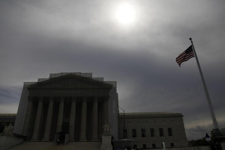 The sun shines through cloud cover above the U.S. Supreme Court building in Washington, June 13, 2013. REUTERS/Jonathan Ernst