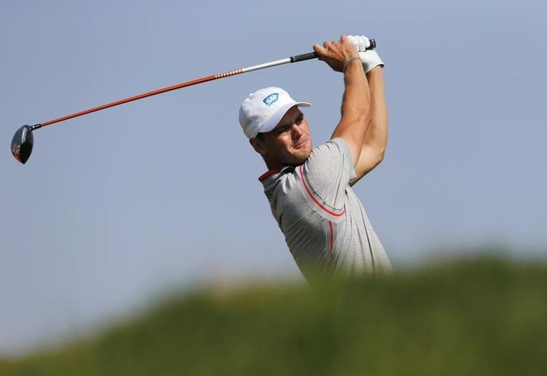 Martin Kaymer of Germany tees off on the third hole during the Abu Dhabi Golf championship January 17, 2014. REUTERS/Ahmed Jadallah