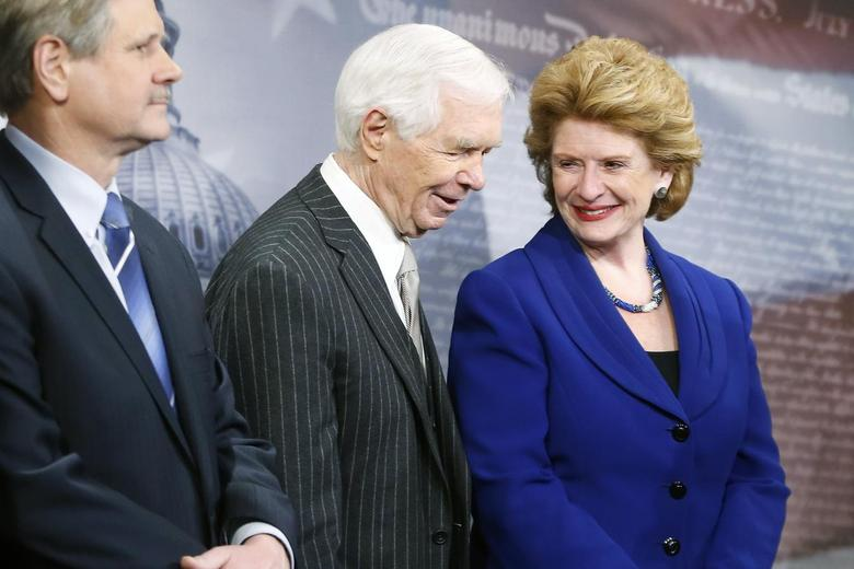 U.S. Senate Agriculture Committee Chairman Debbie Stabenow (D-MI) smiles with ranking member Senator Thad Cochrane (R-MI) (C) at a news conference after the final passage of the Farm Bill at the U.S. Capitol in Washington, February 4, 2014. REUTERS/Jonathan Ernst