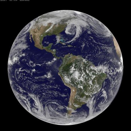 NOAA's GOES-13 and GOES-15 satellite image from March 31, 2014 and released on April 1, 2014 shows the low pressure systems in the eastern Pacific Ocean, over the United States' Heartland, and in the eastern Atlantic Ocean. REUTERS/NASA/Handout via Reuters