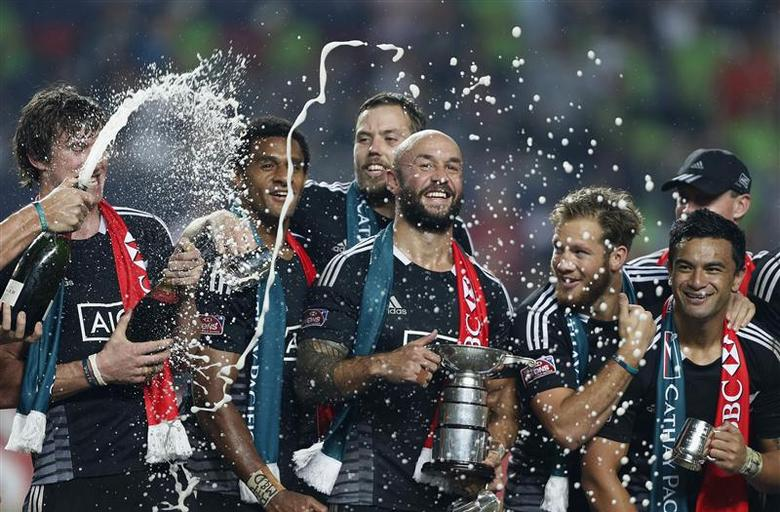 New Zealand captain D J Forbes holds the trophy as he celebrates with his teammates after beating England in the Cup final of the Hong Kong Sevens rugby tournament in Hong Kong March 30, 2014. REUTERS/Bobby Yip