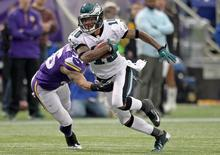 Dec 15, 2013; Minneapolis, MN, USA; Philadelphia Eagles wide receiver DeSean Jackson (10) carries the ball during the fourth quarter against the Minnesota Vikings at Mall of America Field at H.H.H. Metrodome. Brace Hemmelgarn-USA TODAY Sports