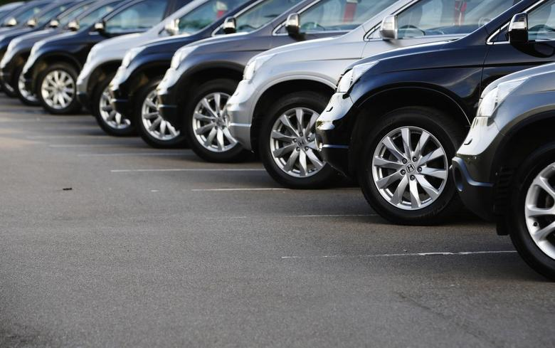 Cars are displayed outside a Volvo showroom in west London October 4, 2013. REUTERS/Luke MacGregor