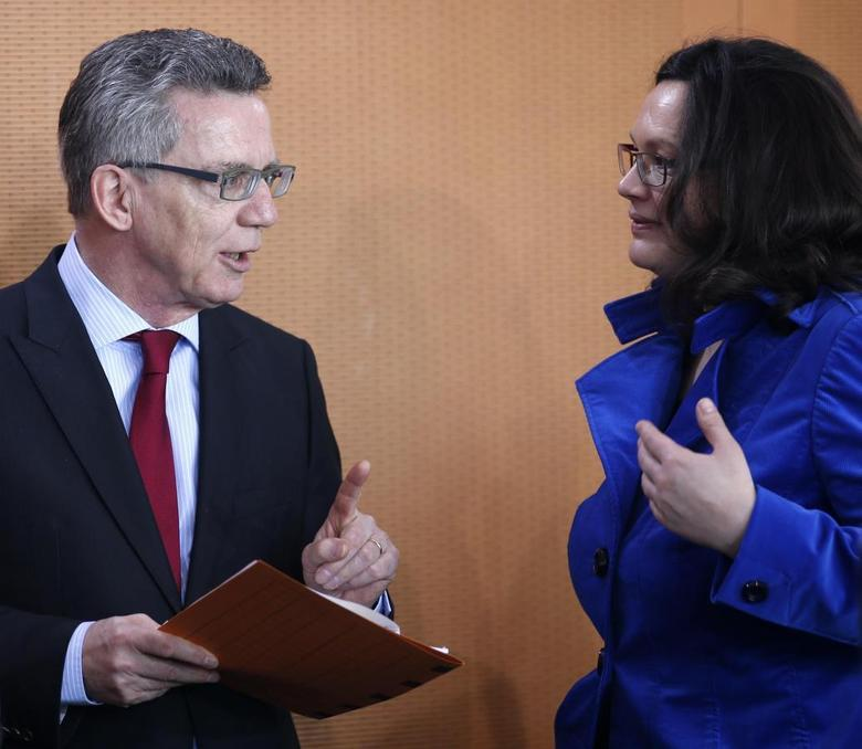 German Labour Minister Andrea Nahles (R) talks to Interior Minister Thomas de Maiziere during a cabinet meeting at the Chancellery in Berlin, April 2, 2014. REUTERS/Fabrizio Bensch