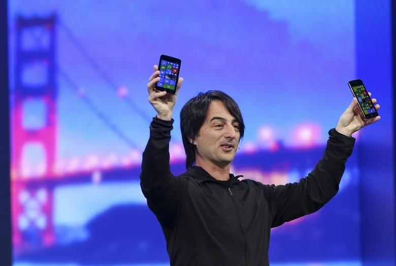 Joe Belfiore, vice president of the operating system group at Microsoft, holds a pair of mobile phones featuring the new Windows 8.1 operating system during the company's ''build'' conference in San Francisco, California April 2, 2014. REUTERS/Robert Galbraith