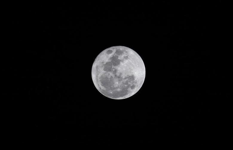 The full moon as seen over Lagos December 17, 2013. REUTERS/Akintunde Akinleye
