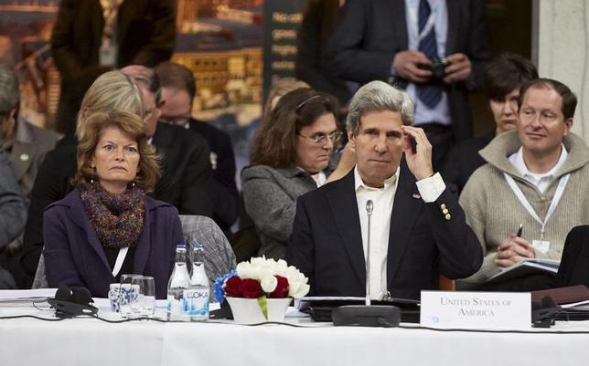 U.S. Secretary of State John Kerry sits next to U.S. Senator Lisa Murkowski (R-Alaska) during the Arctic Council Ministerial Session at City Hall in Kiruna, Sweden, May 15, 2013. REUTERS/Hans-Olof Utsi