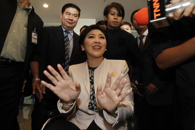 Thai Prime Minister Yingluck Shinawatra reacts as she leaves the National Anti-Corruption Commission office in Nonthaburi province, on the outskirts of Bangkok March 31, 2014. REUTERS/Chaiwat Subprasom