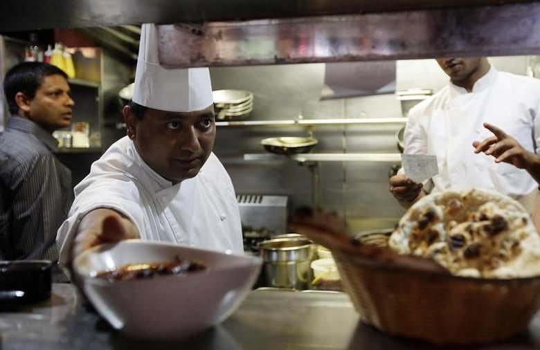 Chef Parvesh Chauhan prepares Vindaloo for diners who will participate in Vindaloo Against Violence by eating dinner at Delhi 'O' Delhi restaurant in Sydney February 24, 2010. Australia/Tim Wimborne