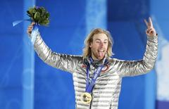 Gold medalist Sage Kotsenburg of the U.S. reacts during the medal ceremony for the men's snowboard slopestyle competition in the Olympic Plaza at the 2014 Sochi Olympic Games February 8, 2014. REUTERS/Eric Gaillard