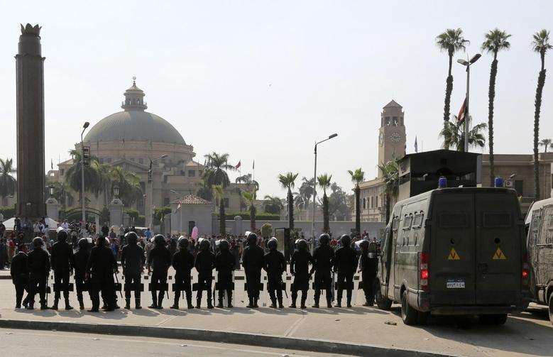 Riot police officers take positions in front of Cairo University, as students who are supporters of the Muslim Brotherhood and deposed President Mohamed Mursi, plan a protest against former Defence Minister Field Marshal Abdel Fattah al-Sisi after Sisi announced that he will run for presidential elections, March 30, 2014. REUTERS/Mohamed Abd El Ghany