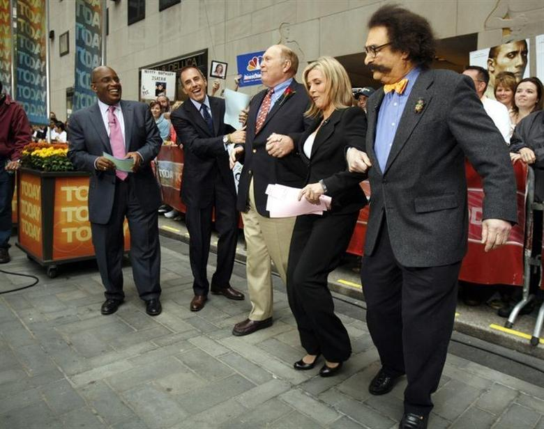 Al Roker (L) and Matt Lauer (2nd L) watch as Willard Scott (C) and Gene Shallot (R) dance with Meredith Vieira during her first day on NBC's 'Today' show in New York September 13, 2006. REUTERS/Brendan McDermid