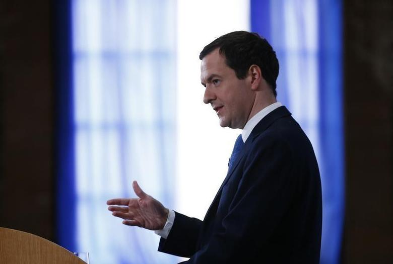 Britain's Chancellor of the Exchequer George Osborne gives a speech about changes to the tax and benefits regime at the old passenger terminal in Tilbury Docks, east of London March 31, 2014. REUTERS/Andrew Winning