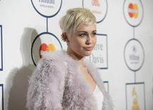Singer Miley Cyrus attends the Clive Davis Pre-Grammy Gala and Salute to Industry Icons, honoring Universal Music Group Chairman and CEO Lucian Grainge, in Beverly Hills, California January 25, 2014. REUTERS/Phil McCarten