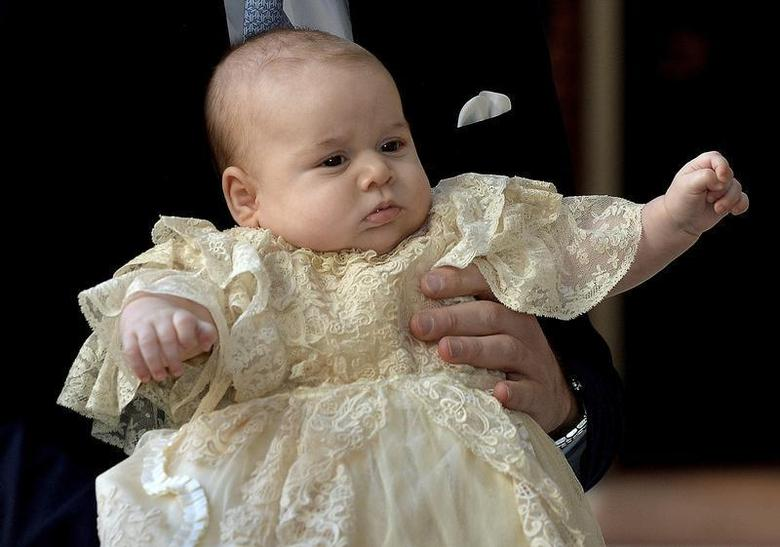 Britain's Prince William carries his son Prince George as they arrive for his son's christening at St James's Palace in London October 23, 2013. REUTERS/John Stillwell/pool