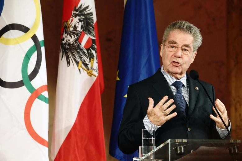 Austrian president Heinz Fischer addresses members of Austria's Olympic team during their swearing in ceremony inside the imperial Hofburg palace in Vienna January 29, 2014.