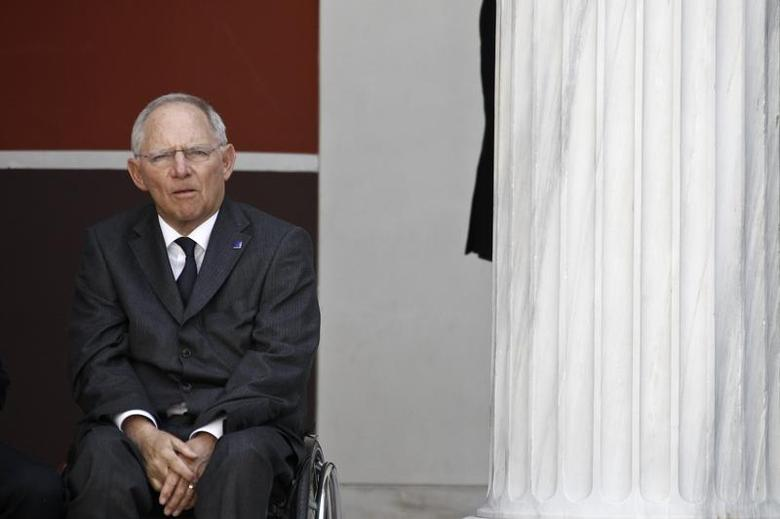 Germany's Finance Minister Wolfgang Schaeuble waits for a family photo during a European Union Finance Ministers informal meeting in Athens April 1, 2014. REUTERS/Alkis Konstantinidis