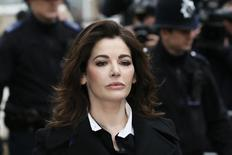 TV chef Nigella Lawson arrives at Isleworth Crown Court in west London December 4, 2013. REUTERS/Stefan Wermuth