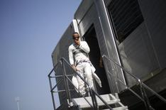 Mercedes Formula One driver Lewis Hamilton of Britain walks down stairs during the second practice session of the Italian F1 Grand Prix at the Monza circuit September 6, 2013. REUTERS/Max Rossi