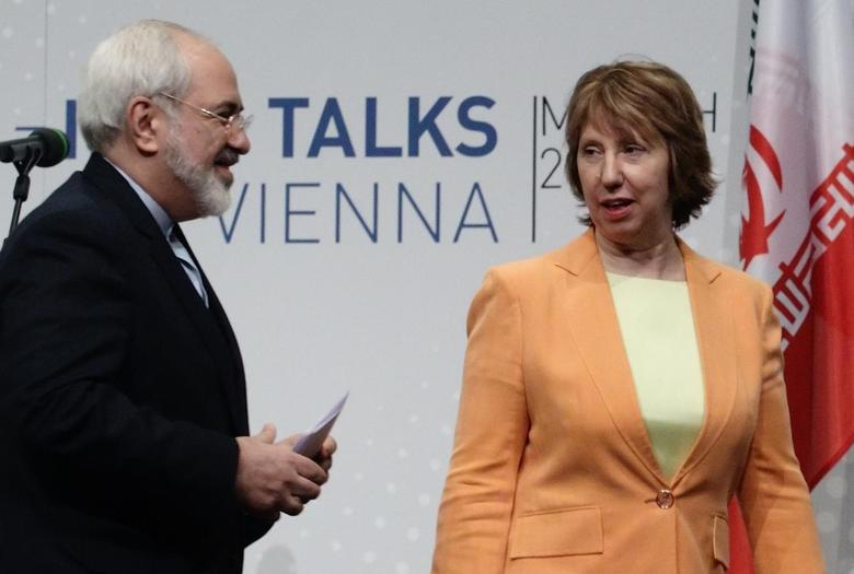 Iranian Foreign Minister Mohammad Javad Zarif (L) and European Union foreign policy chief Catherine Ashton leave a news conference in Vienna March 19, 2014. REUTERS/Heinz-Peter Bader