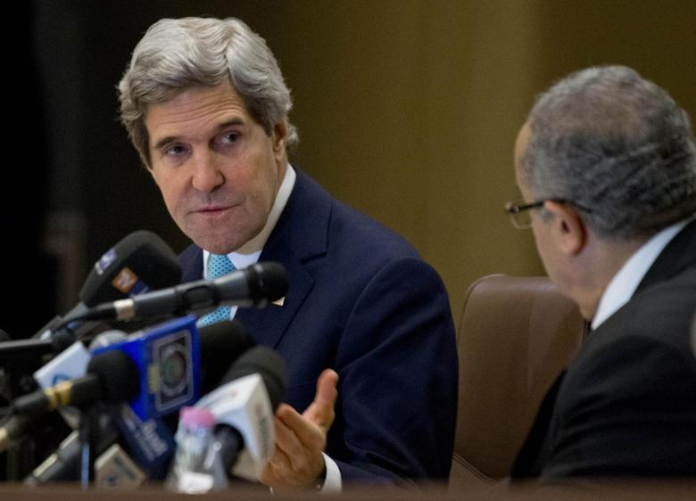 U.S. Secretary of State John Kerry makes opening remarks at the start of a U.S.-Algeria Strategic Dialogue with Algerian Foreign Minister Ramtane Lamamra (R) in Algiers April 3, 2014. REUTERS/Jacquelyn Martin/Pool