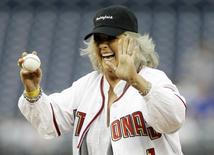 Food Network personality Paula Deen laughs before throwing out the first pitch prior to the Washington Nationals versus New York Mets MLB baseball game in Washington, May 19, 2010. REUTERS/Gary Cameron