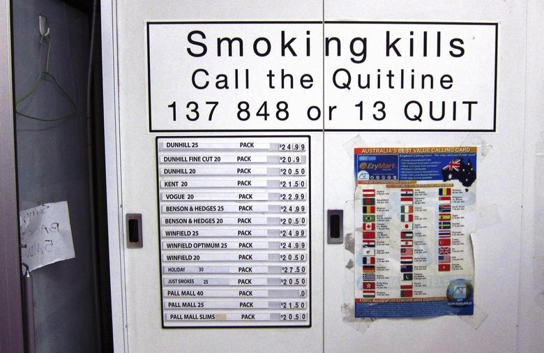 A telephone card advertisement is seen on a cabinet next to a list displaying prices for the cigarettes inside it at a small shop in central Sydney April 4, 2014. REUTERS/David Gray