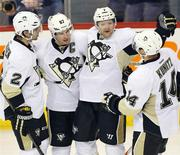 Apr 3, 2014; Winnipeg, Manitoba, CAN; Pittsburgh Penguins defenseman Paul Martin (7) celebrates with teammates after scoring a goal during the third period against the Winnipeg Jets at MTS Centre. The Penguins won 4-2. Mandatory Credit: Bruce Fedyck-USA TODAY Sports