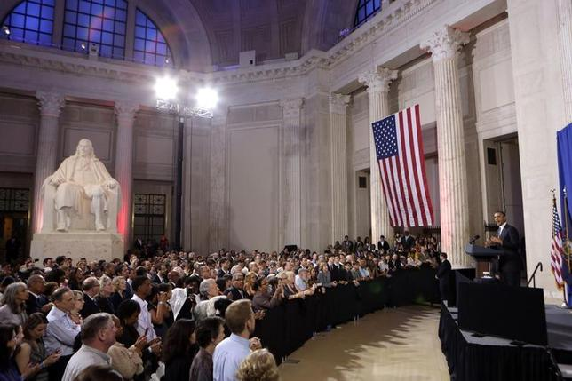 U.S. President Barack Obama speaks at a campaign fund raising event at the Franklin Institute in Philadelphia, Pennsylvania, June 12, 2012. The statue in the room is of Benjamin Franklin. REUTERS/Kevin Lamarque