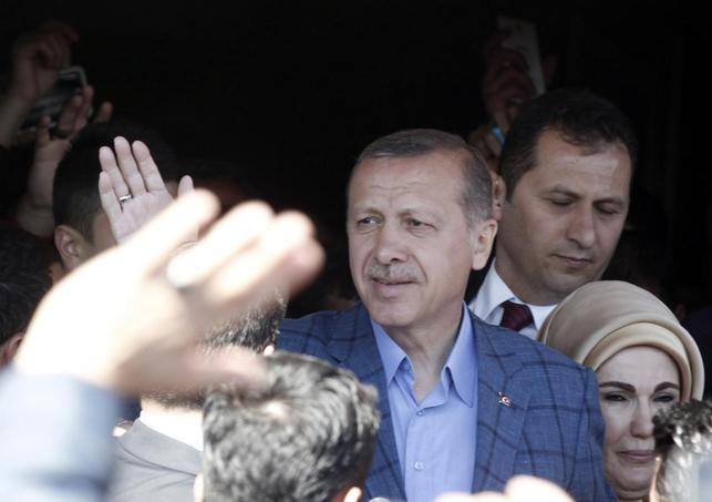 Turkey's Prime Minister Tayyip Erdogan acknowledges supporters outside a polling station during the municipal elections in Istanbul March 30, 2014. REUTERS/Osman Orsal